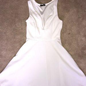 Small vneck mini white dress   worn once